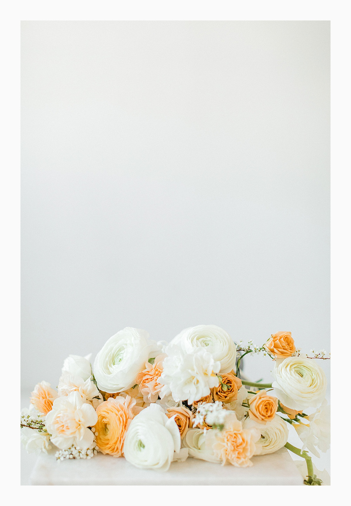 The Bemis Building in downtown Seattle is one of my favorite places to use for photo shoots!  This styled bridal shoot with touches of peach and white was dreamy.  #emmarosecompany #kindredpresets #seattlebride_0005.jpg