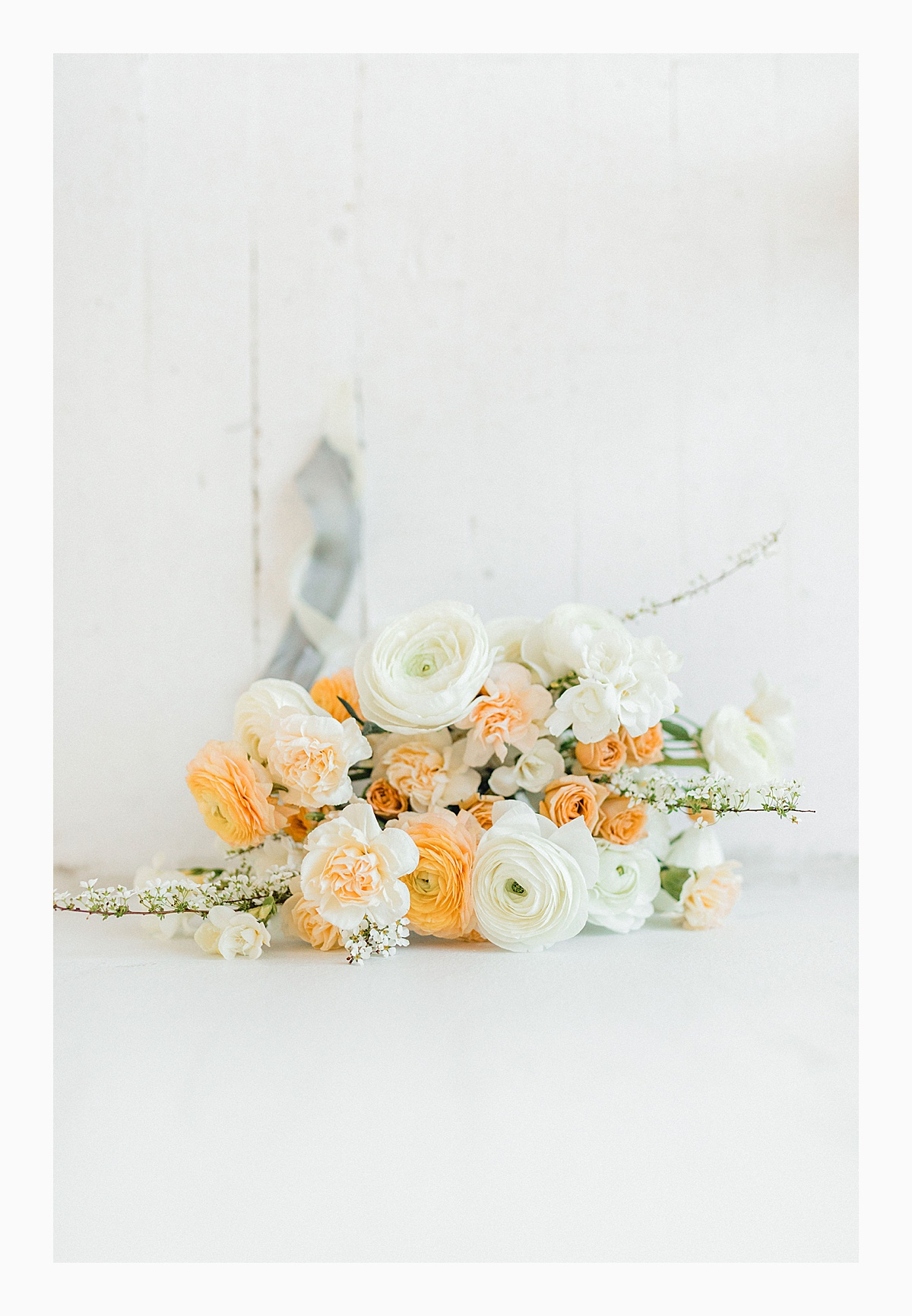 The Bemis Building in downtown Seattle is one of my favorite places to use for photo shoots!  This styled bridal shoot with touches of peach and white was dreamy.  #emmarosecompany #kindredpresets #seattlebride_0008.jpg