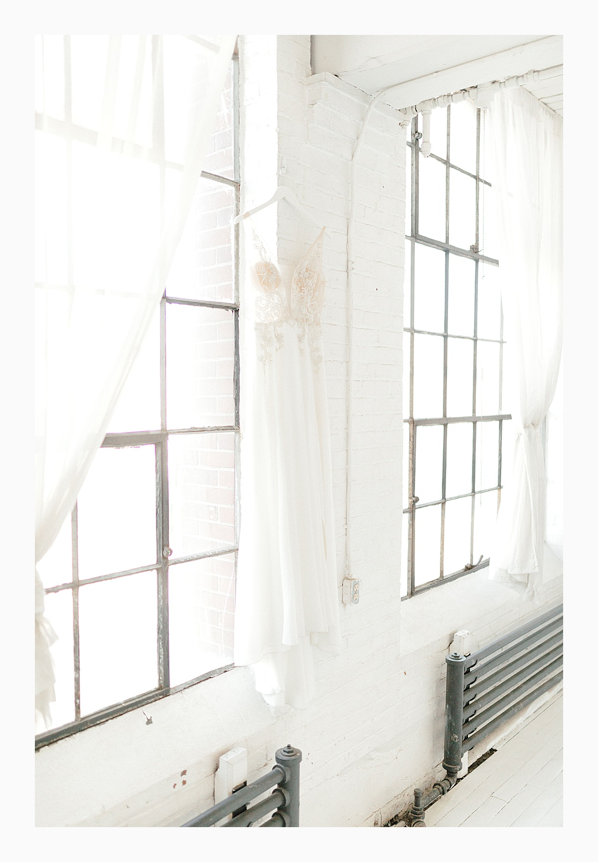 The Bemis Building in downtown Seattle is one of my favorite places to use for photo shoots!  This styled bridal shoot with touches of peach and white was dreamy.  #emmarosecompany #kindredpresets #seattlebride_0009.jpg