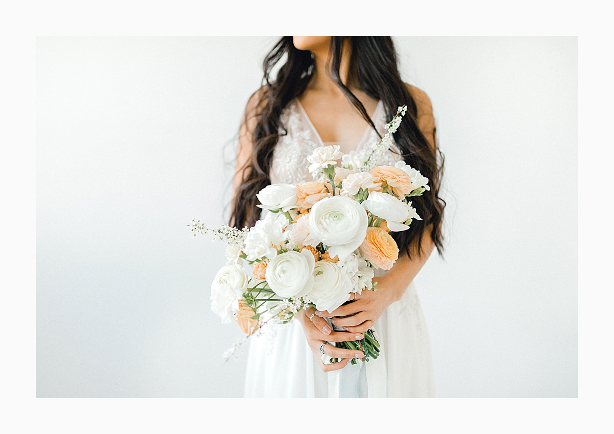 The Bemis Building in downtown Seattle is one of my favorite places to use for photo shoots!  This styled bridal shoot with touches of peach and white was dreamy.  #emmarosecompany #kindredpresets #seattlebride_0014.jpg