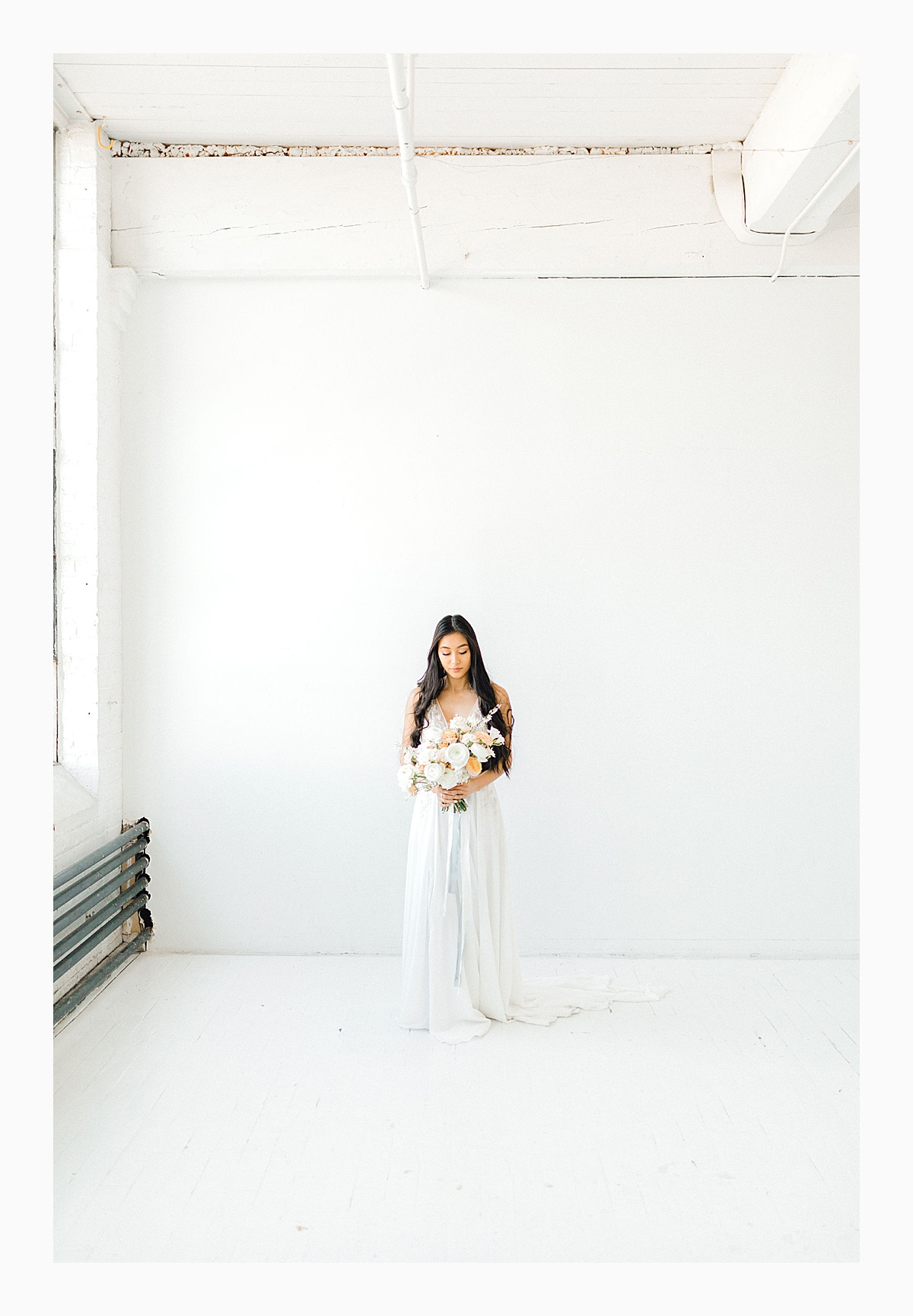 The Bemis Building in downtown Seattle is one of my favorite places to use for photo shoots!  This styled bridal shoot with touches of peach and white was dreamy.  #emmarosecompany #kindredpresets #seattlebride_0015.jpg