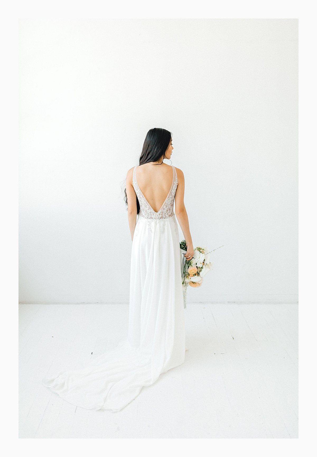 The Bemis Building in downtown Seattle is one of my favorite places to use for photo shoots!  This styled bridal shoot with touches of peach and white was dreamy.  #emmarosecompany #kindredpresets #seattlebride_0016.jpg