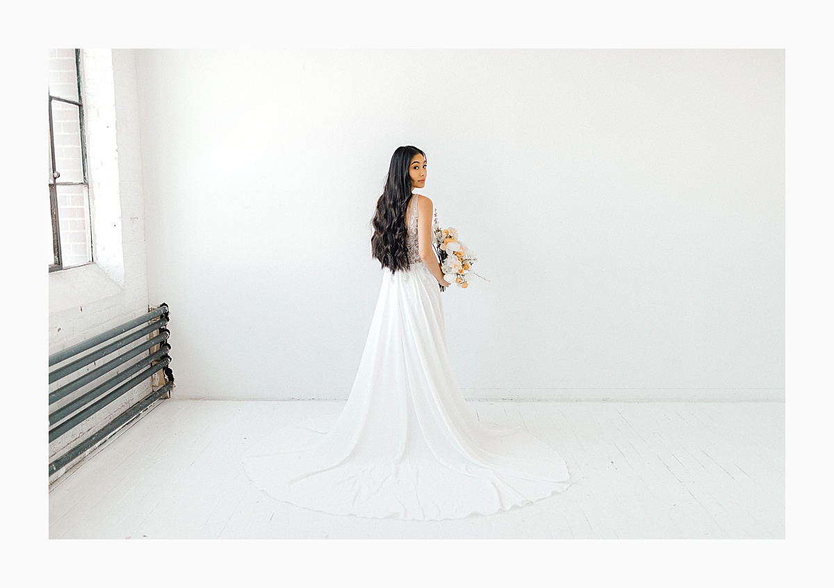 The Bemis Building in downtown Seattle is one of my favorite places to use for photo shoots!  This styled bridal shoot with touches of peach and white was dreamy.  #emmarosecompany #kindredpresets #seattlebride_0022.jpg