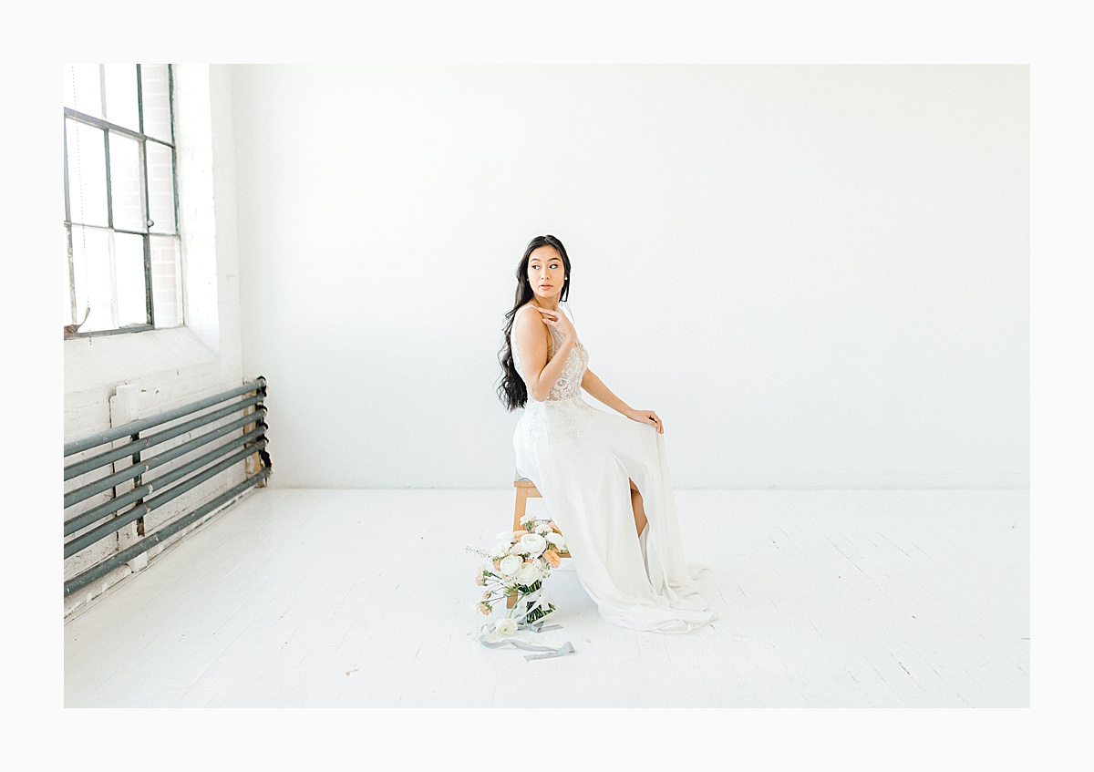 The Bemis Building in downtown Seattle is one of my favorite places to use for photo shoots!  This styled bridal shoot with touches of peach and white was dreamy.  #emmarosecompany #kindredpresets #seattlebride_0024.jpg