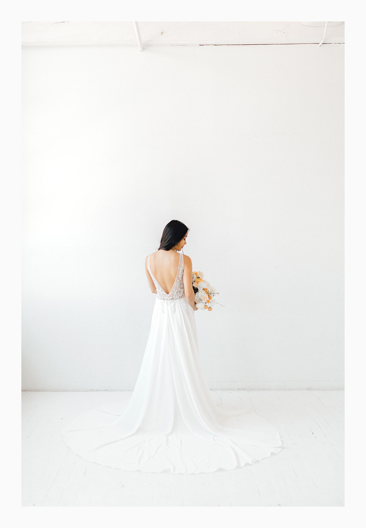 The Bemis Building in downtown Seattle is one of my favorite places to use for photo shoots!  This styled bridal shoot with touches of peach and white was dreamy.  #emmarosecompany #kindredpresets #seattlebride_0023.jpg