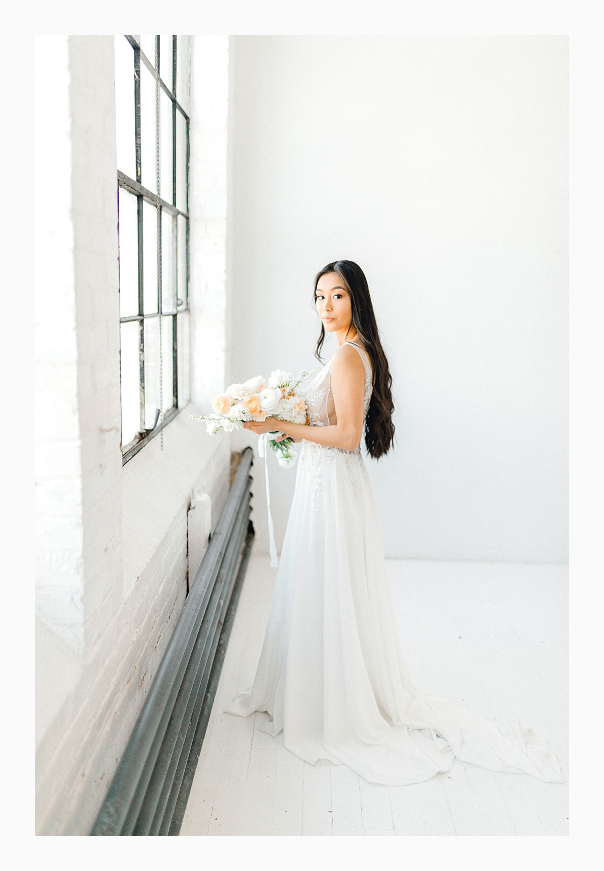 The Bemis Building in downtown Seattle is one of my favorite places to use for photo shoots!  This styled bridal shoot with touches of peach and white was dreamy.  #emmarosecompany #kindredpresets #seattlebride_0025.jpg