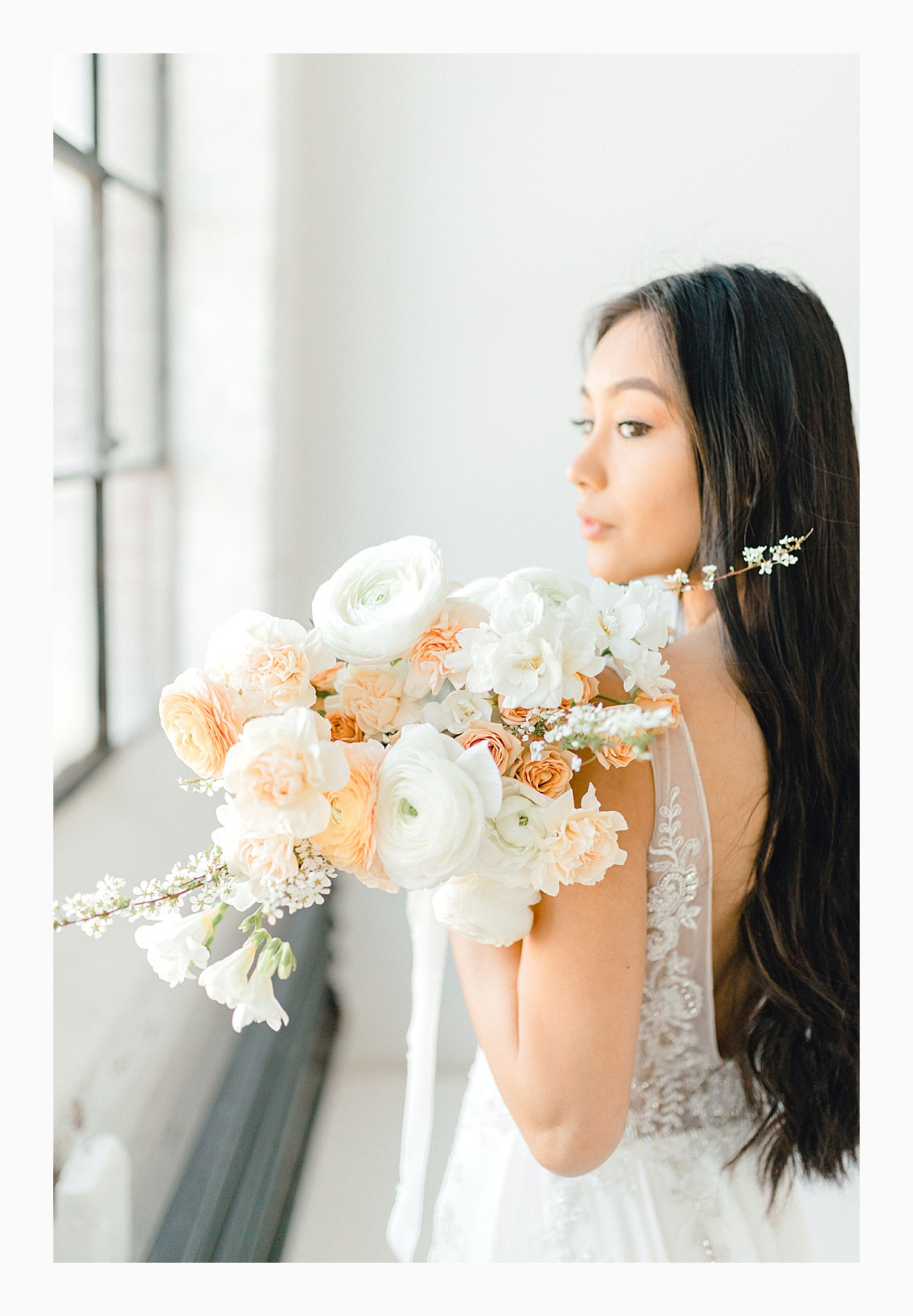 The Bemis Building in downtown Seattle is one of my favorite places to use for photo shoots!  This styled bridal shoot with touches of peach and white was dreamy.  #emmarosecompany #kindredpresets #seattlebride_0026.jpg
