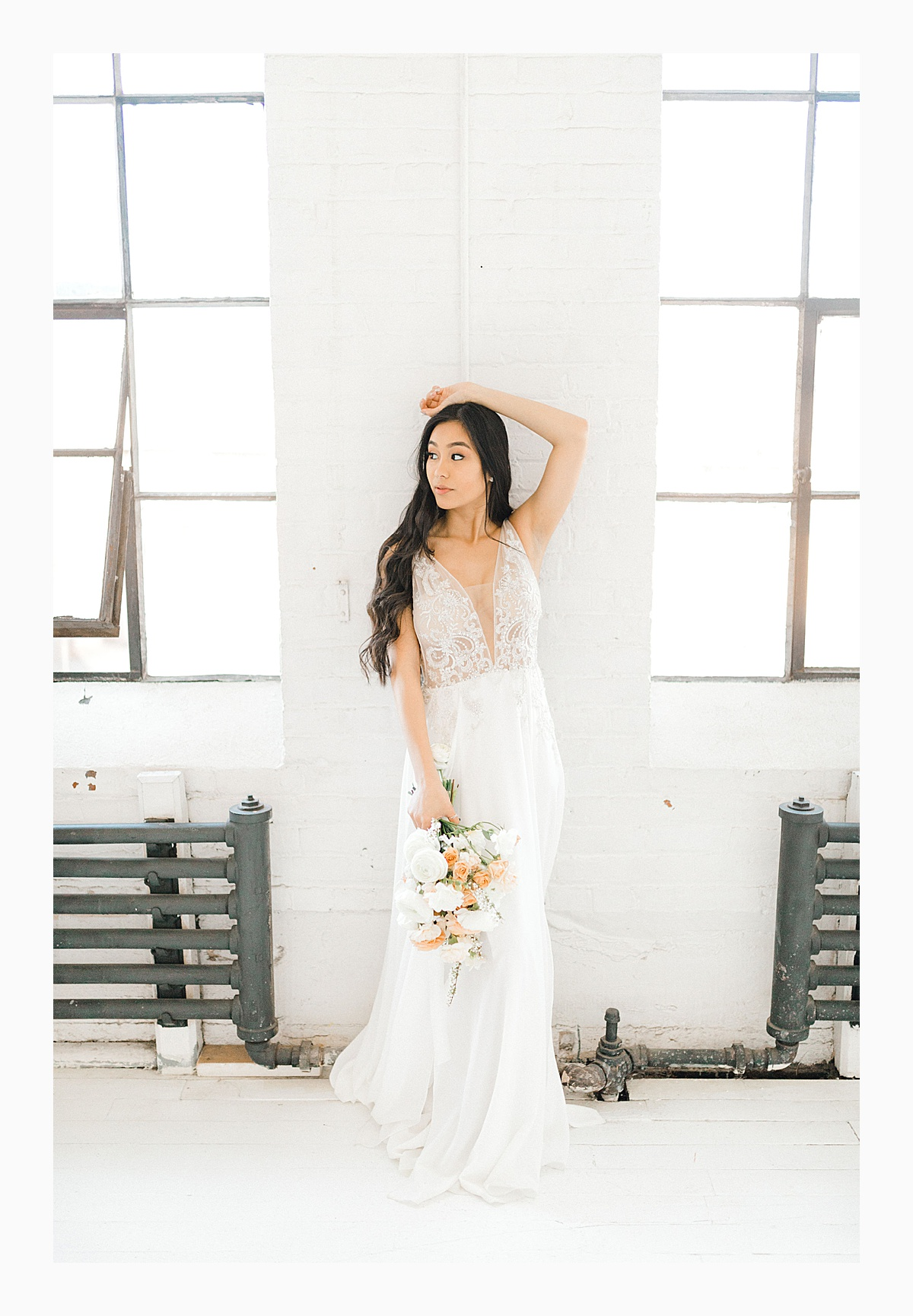 The Bemis Building in downtown Seattle is one of my favorite places to use for photo shoots!  This styled bridal shoot with touches of peach and white was dreamy.  #emmarosecompany #kindredpresets #seattlebride_0027.jpg