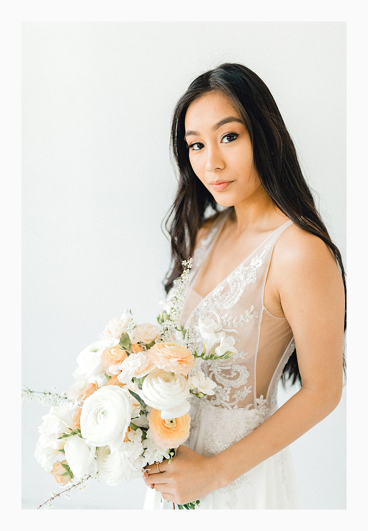 The Bemis Building in downtown Seattle is one of my favorite places to use for photo shoots!  This styled bridal shoot with touches of peach and white was dreamy.  #emmarosecompany #kindredpresets #seattlebride_0028.jpg