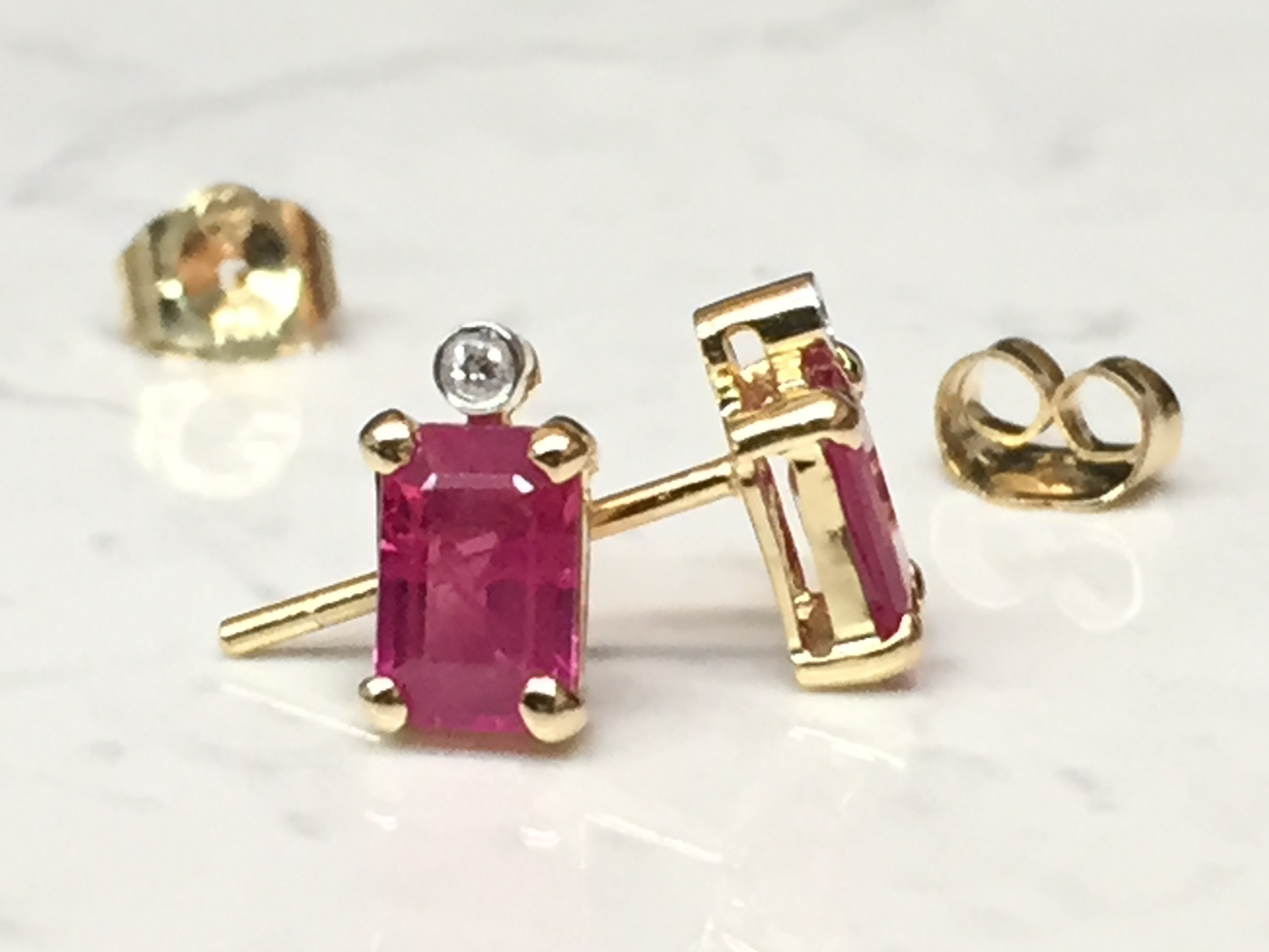 Gorgeous step-cut Ruby earrings with diamond accents