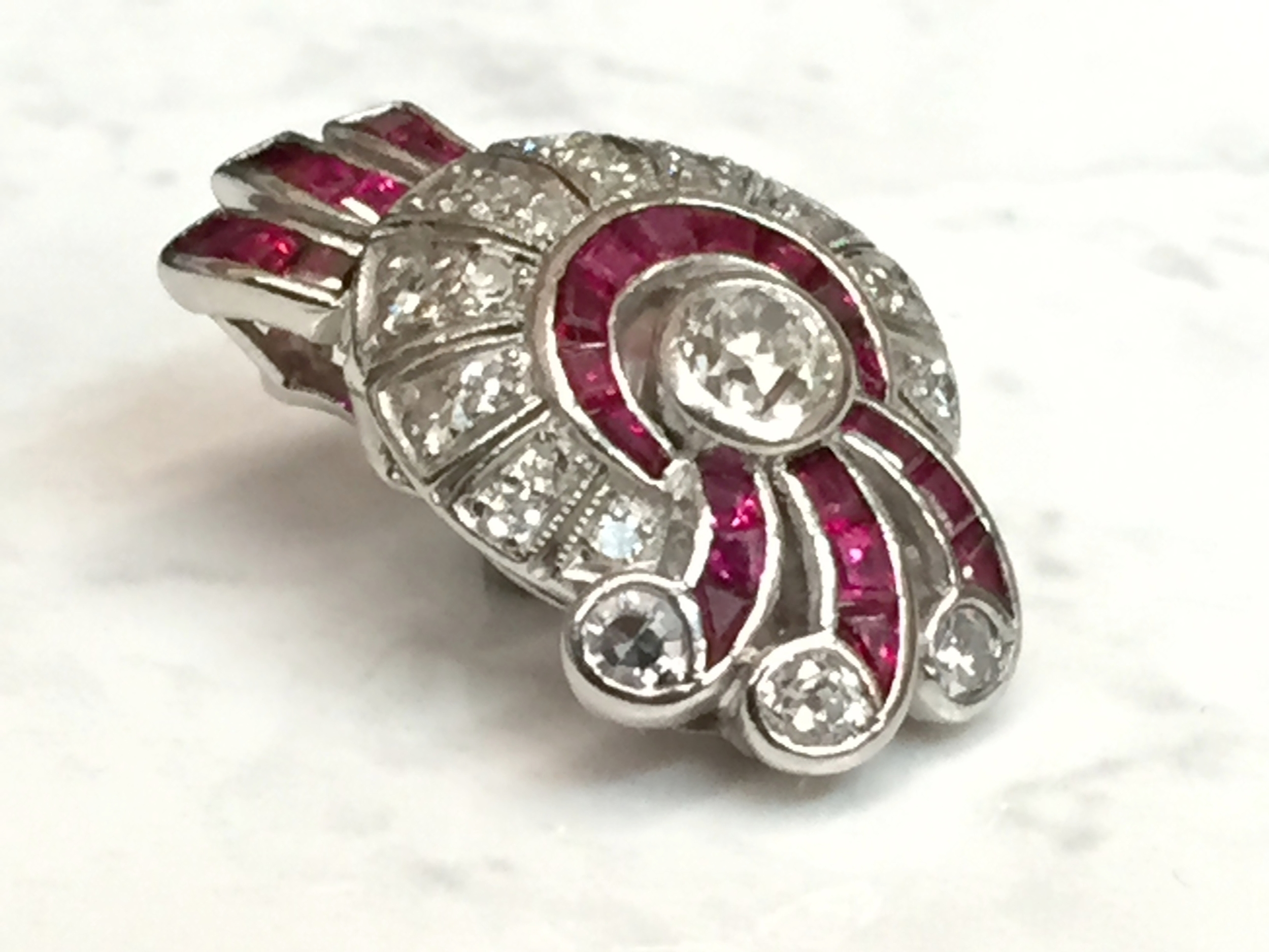 With Pigeon Blood Rubies, Diamonds and Platinum, this unique pendant will turn heads wherever you go