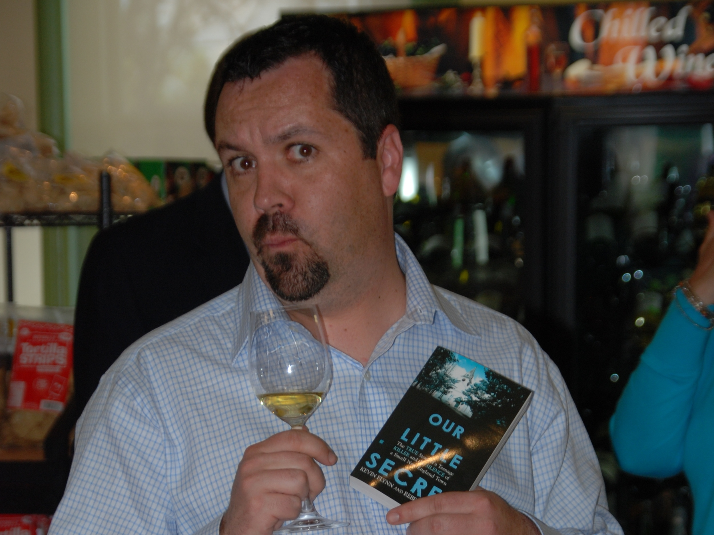 Kevin have wine and cheese at the launch party for  Our Little Secret .  Despite what you might think, white wine is a better pairing for true crime.