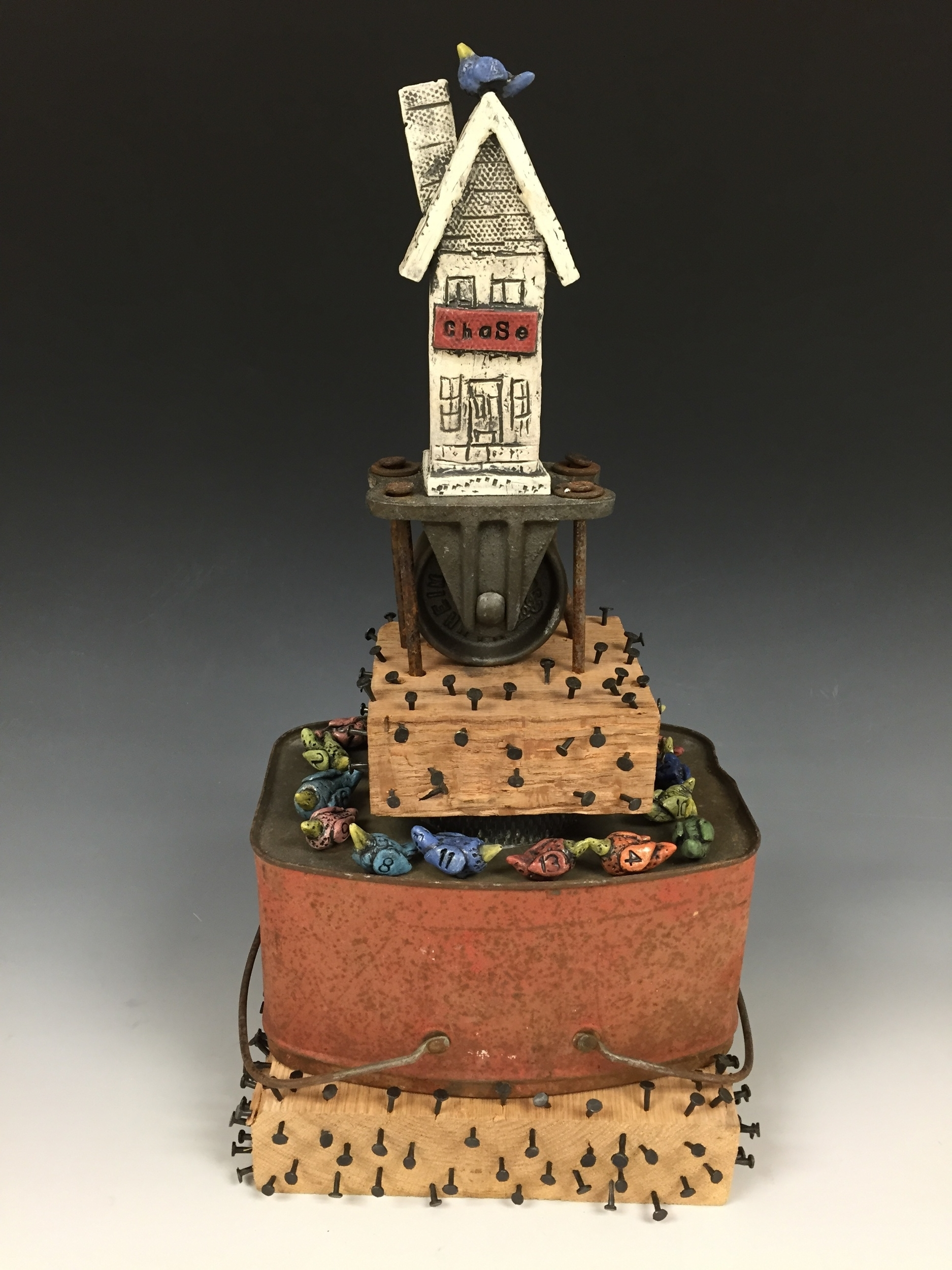 """Chase""  22""x 8"" x 8""  clay and found objects"