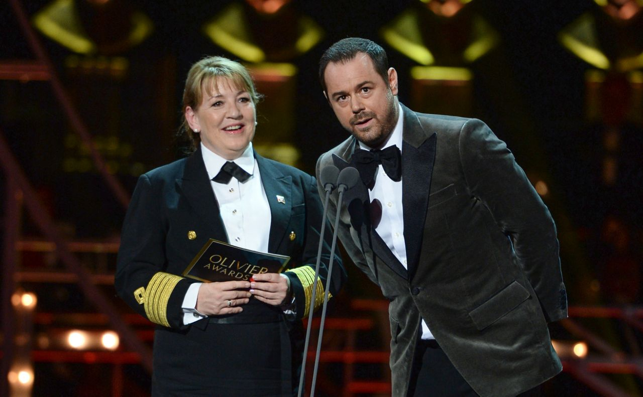 Danny Dyer (R) and Cunard Captain Inger Klein Thorhauge on stage during The Olivier Awards 2019