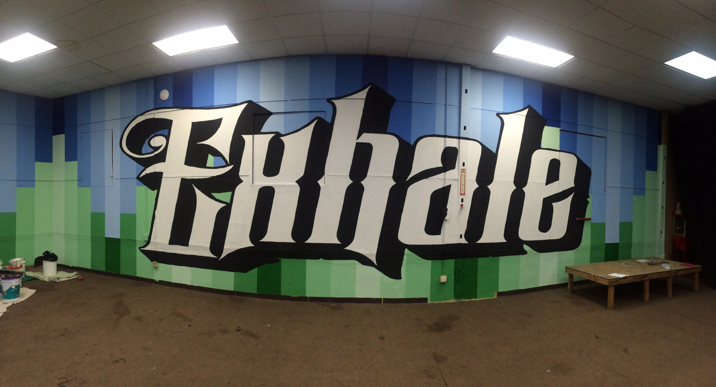 That lettering is at least nine feet tall! Despite the large scale, this is actually pretty easy to make happen. All you need is the  Exhale Inhale  Art, a projector, and some paint!