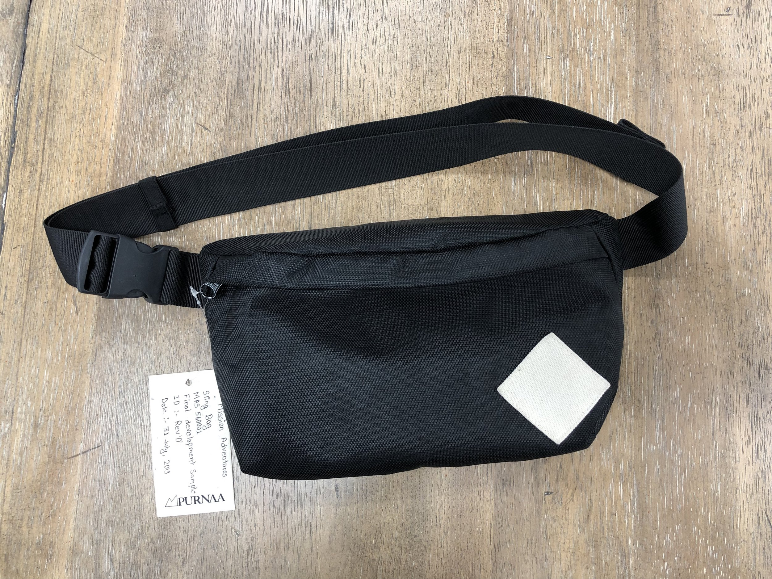 """This prototype appears to be a """"sling bag"""" and would be worn either around the waist or over the shoulder. Note the high quality fabric. Approximately 12 in. wide, by 6 in. tall, by 3 in. deep."""
