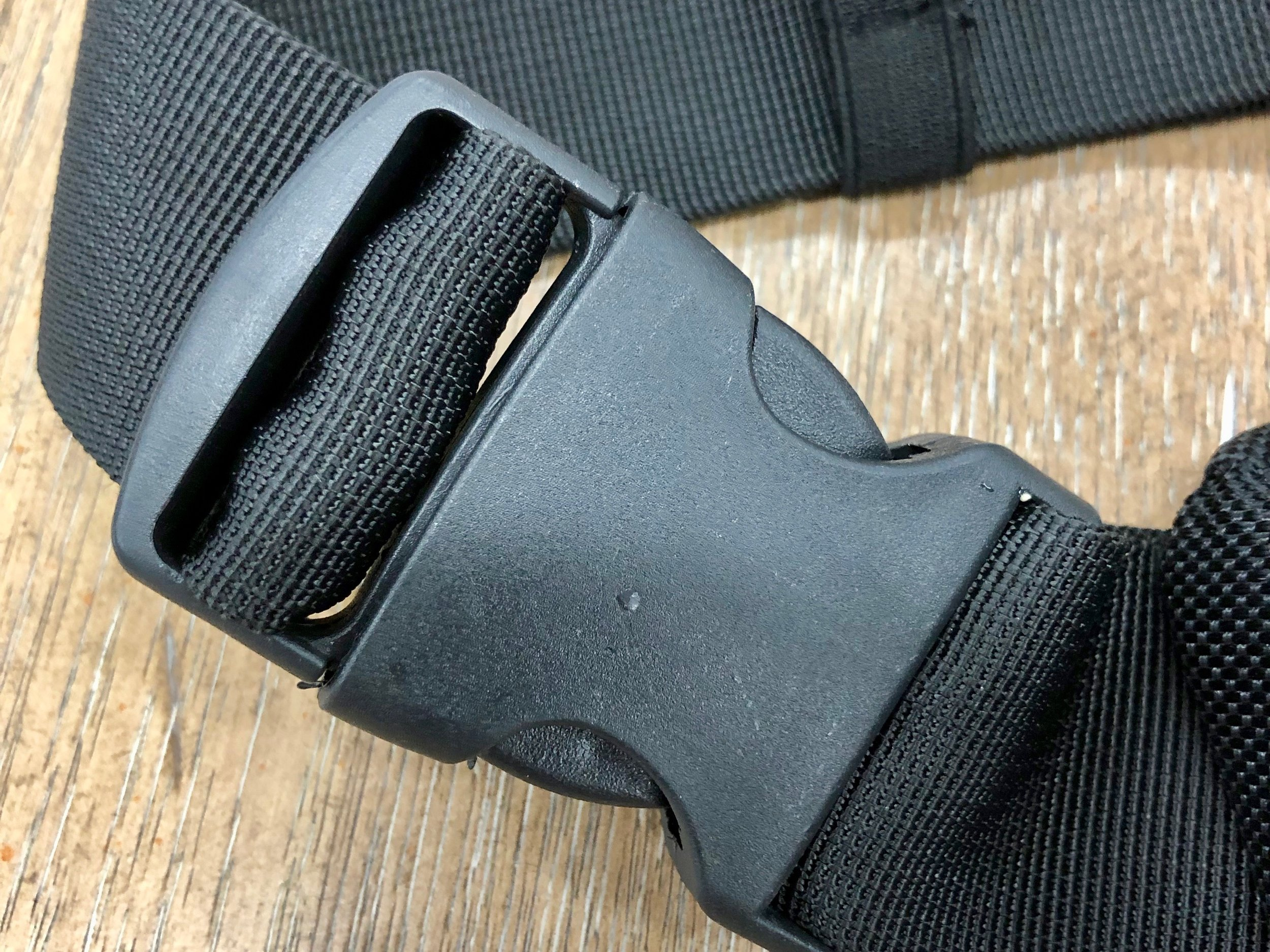 Note the high quality buckle for easy on, easy off. The strap is also high quality webbing, similar to what you'd find on a seatbelt. And it adjusts from very very small, to plenty big.