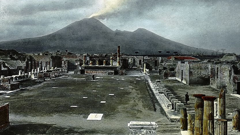 Ruins of Pompeii    with Mt. Vesuvius in the background (c. 1900) - Wikimedia Commons (Public Domain)
