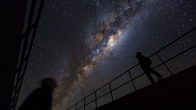 Beneath the Milky Way    (cropped), by ESO/Luis Calcada/Herbert Zodet — Wikimedia Creative Commons (   License   )