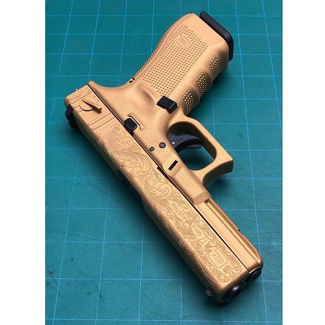 Opulence.  Glock 17 post-'86 Dealer Sample by @lonestararmory  Engraving by @monch817  Gold Cerakote @cerakote  #Custom #engraved #engraving #opulence #fancy #Gold #Cerakote #Glock #Glock18 #FullAutoFriday