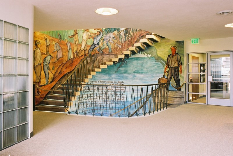 Fluorescent light troughs in the floor's edge were updated to better reveal the colorful mural as the workers used the staircase.