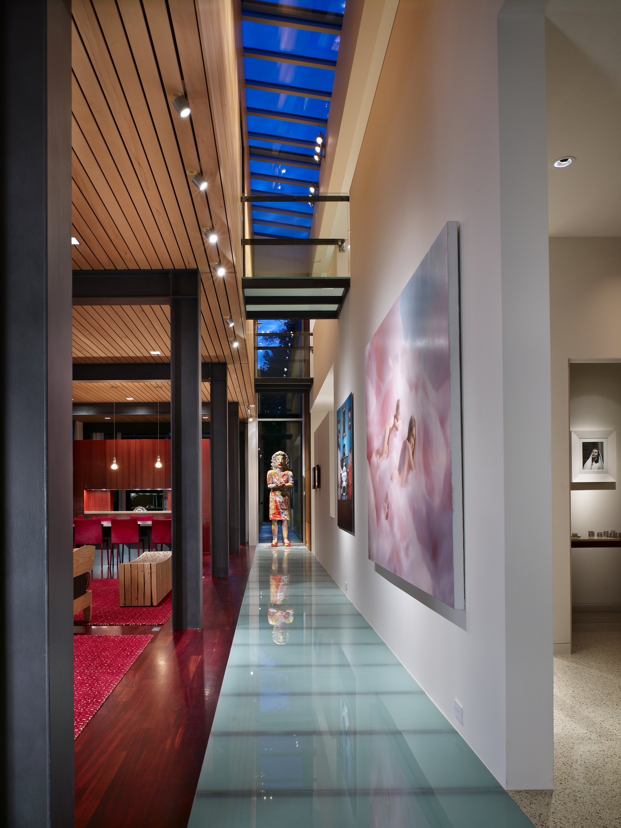 In collaboration with the architects, we up-lit the glass floor from the media room below, and recessed the gallery track above removable ceiling planks.