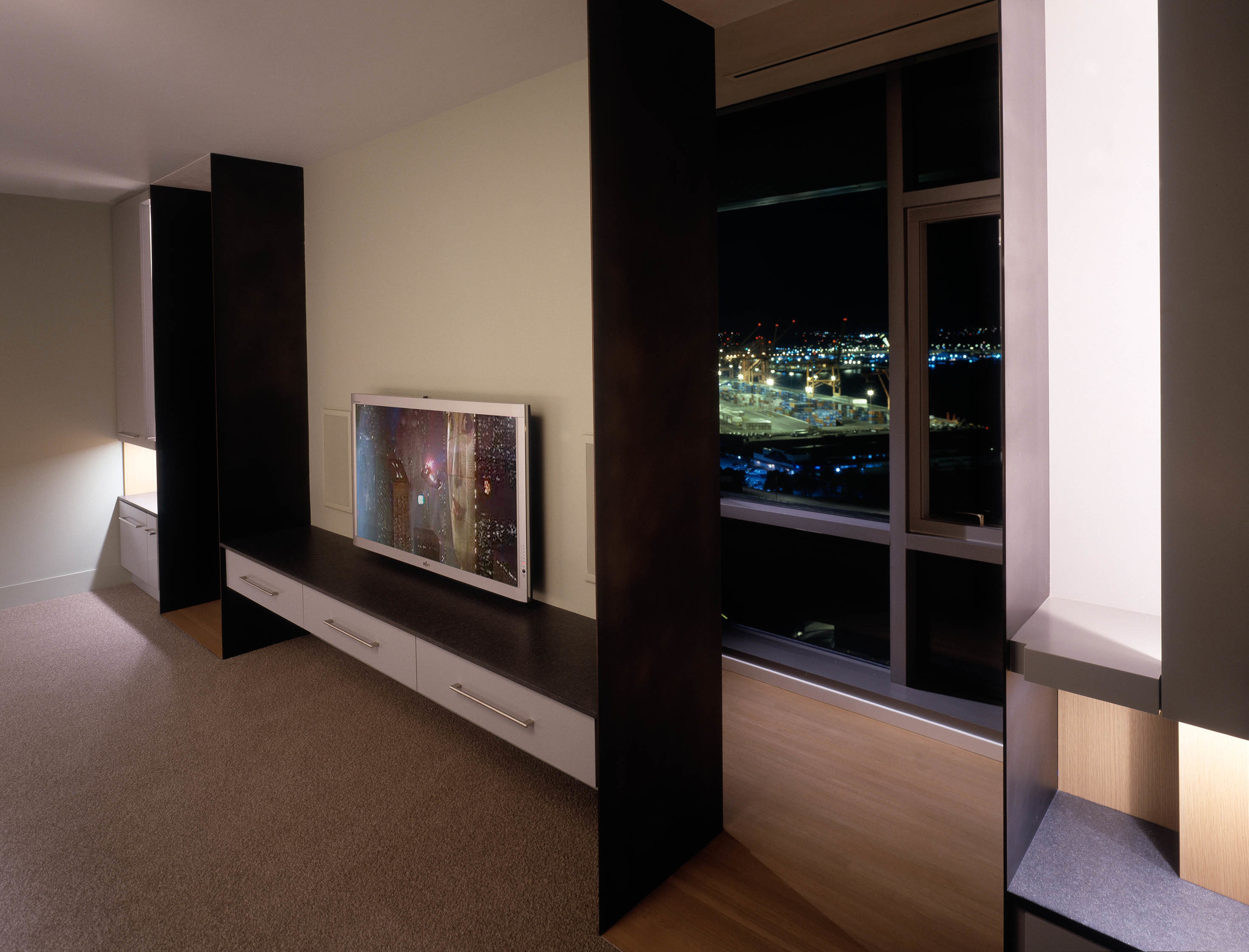 The entertainment room was screened off from the dramatic view beyond and lit with soft, indirect lighting.
