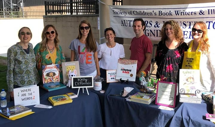 Janet Heller, Kelly DiPucchio, Jodi McKay, Amy Nielander, Jeff Jantz, me, and Gin Price--the SCBWI-Michigan PALS at our table with our books.