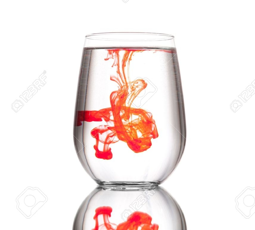 16681910-A-drop-of-red-food-coloring-in-a-glass-cup-filled-with-clear-water-against-a-white-background-Stock-Photo.jpg