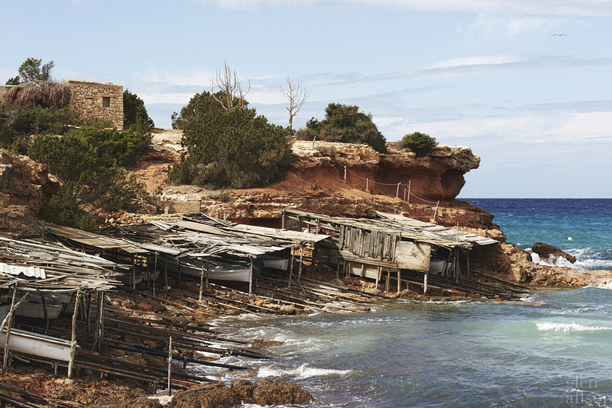 red rock-formentera-cliffs-boathouse