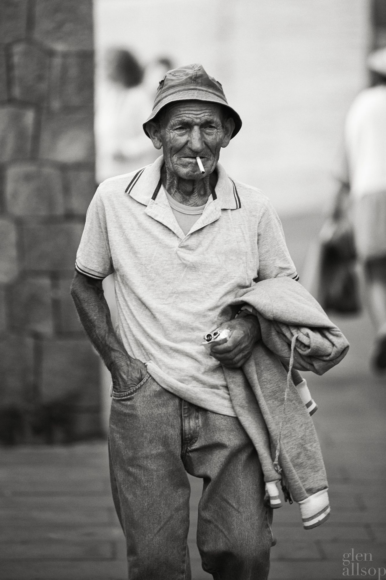on the street-ischia-portrait-black and white-sea-weathered face-fisherman-bucket hat