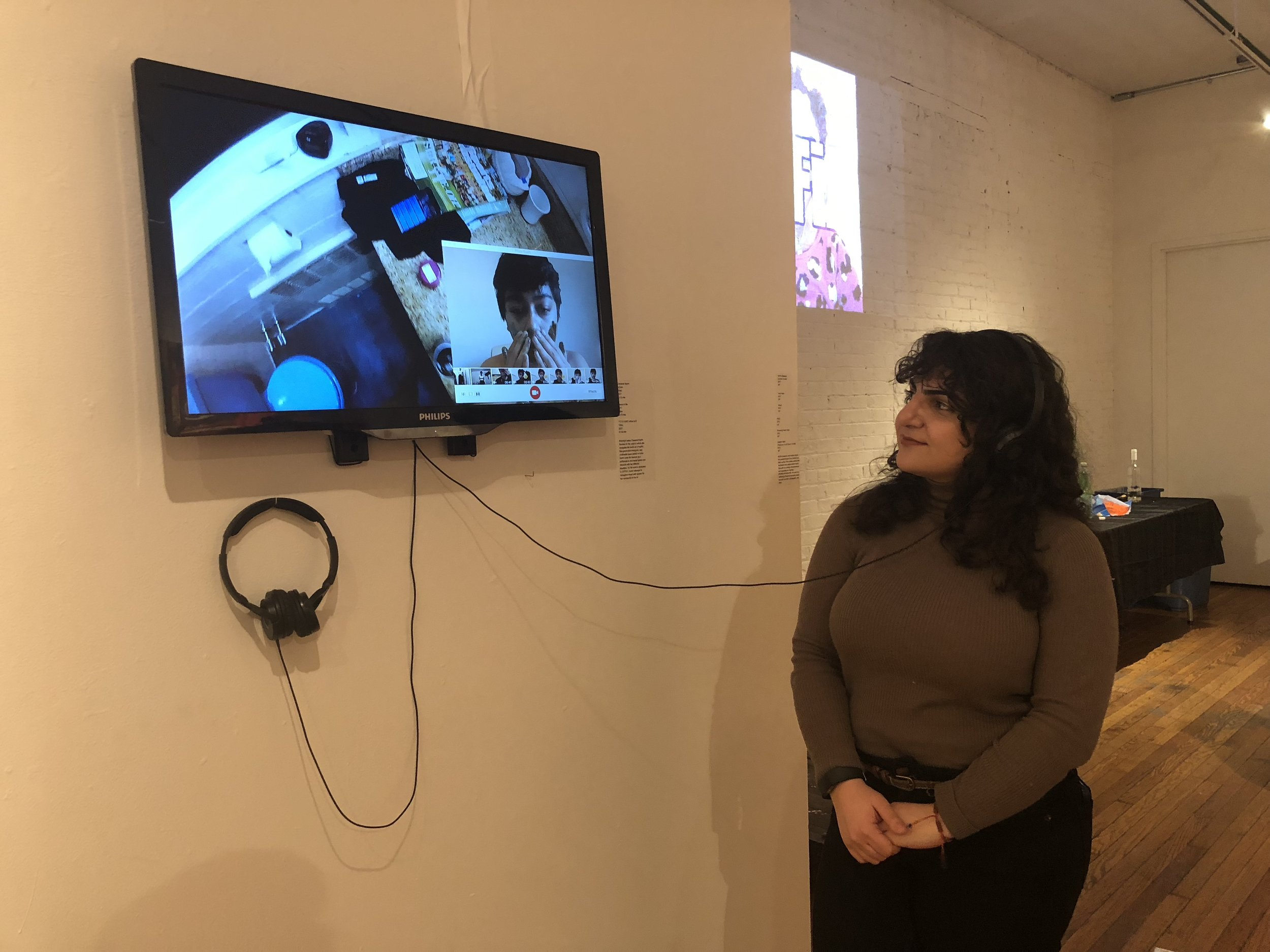 """Isabella viewing Cy-Fi's work on display at """"For Us"""""""