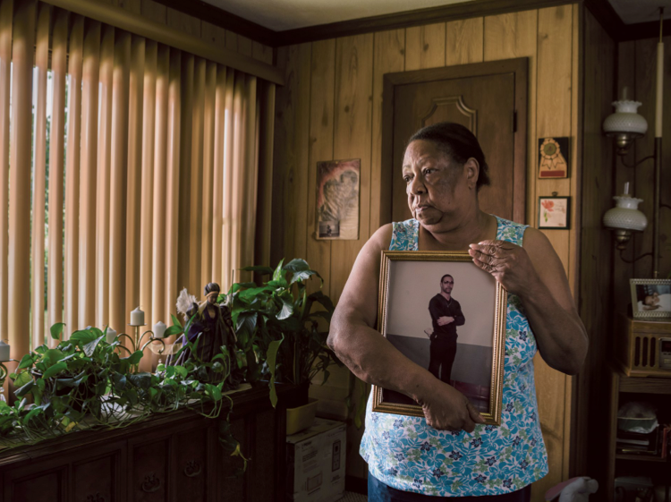 Clara Newton at her home outside Baltimore, holding a picture of her son Odell, who has been in prison for 41 years for a crime he committed when he was 16. State o  ffi  cials have recommended Odell for release three times since 1992, but he has not been freed. August 4, 2015.