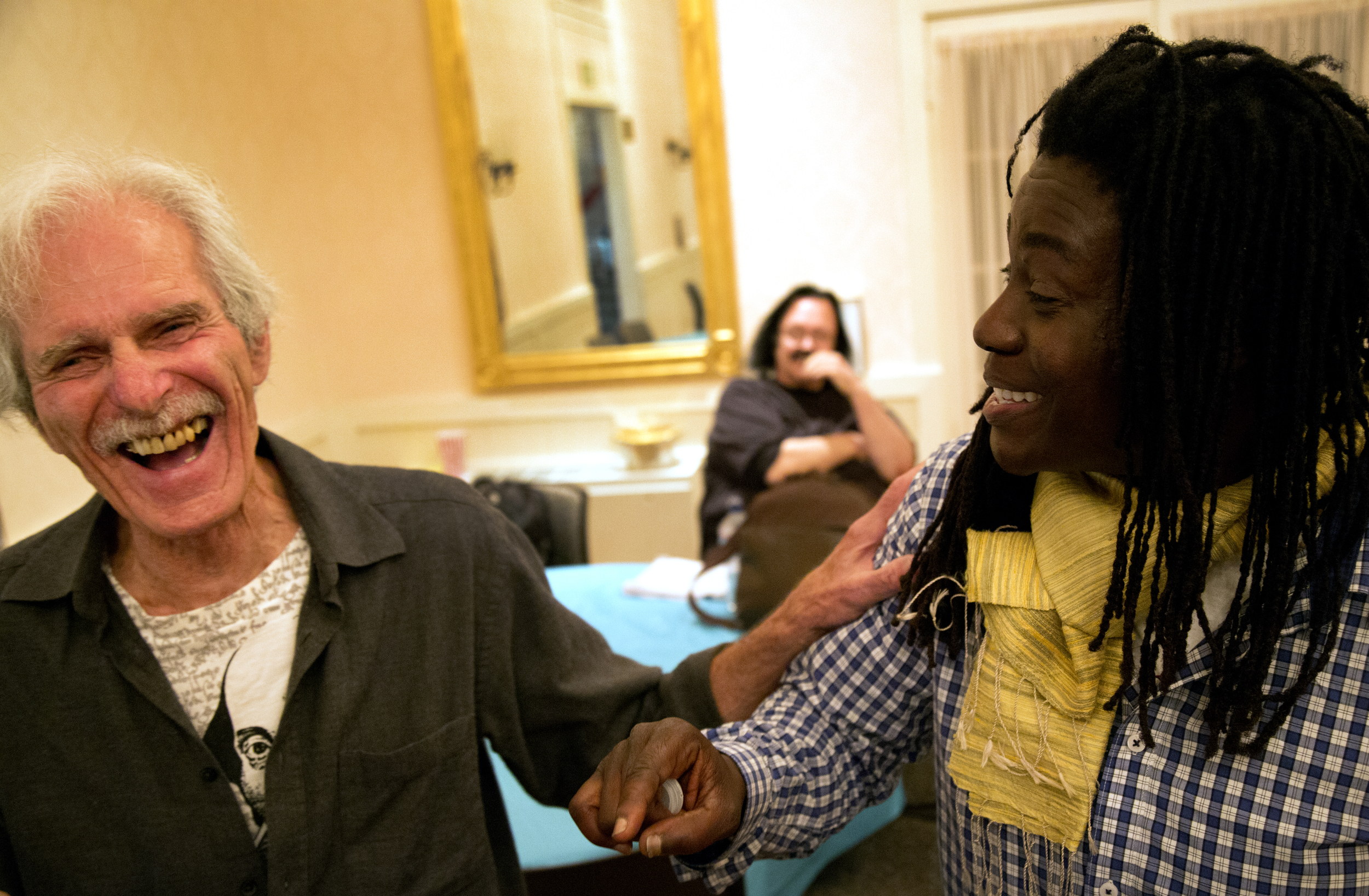 Skyler Cooper and Gene Gordon share a moment of joy before a small Othello production presented by The Rossmoor Shakespeare Society in the Dollar Club House in Rossmoor, Calif. Thursday April 9, 2015.