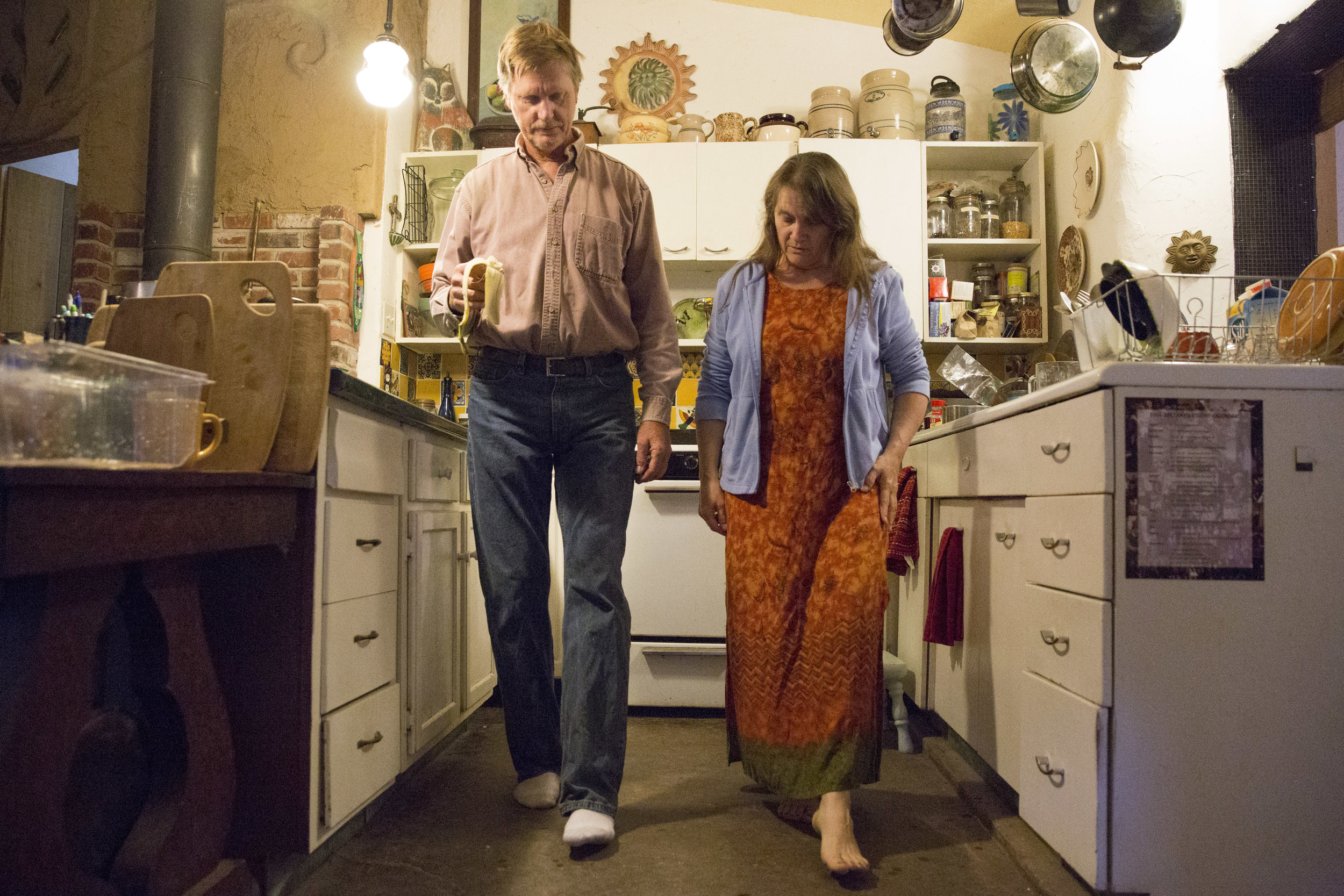 Lorian Moore teaches Rex Rohrer walking meditation in their kitchen. Moore attends meditation at Lisa Hoovers house every Wednesday morning.