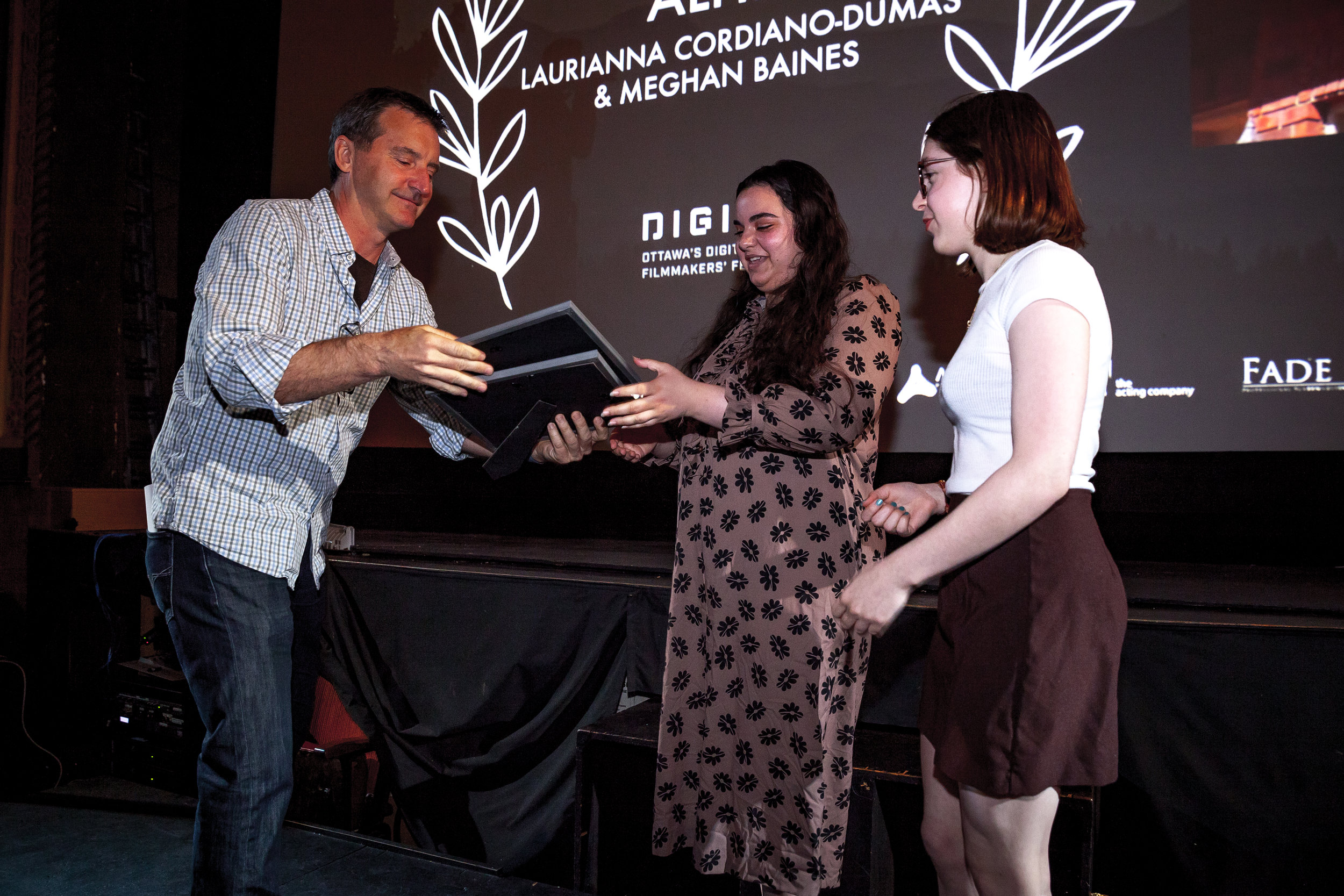 Co-Filmmakers Laurianna Cordiano-Dumas & Meghan Baines being presented with their Best Film award by Digi60 President, Kevin Burton at the 2019 Spring Festival.