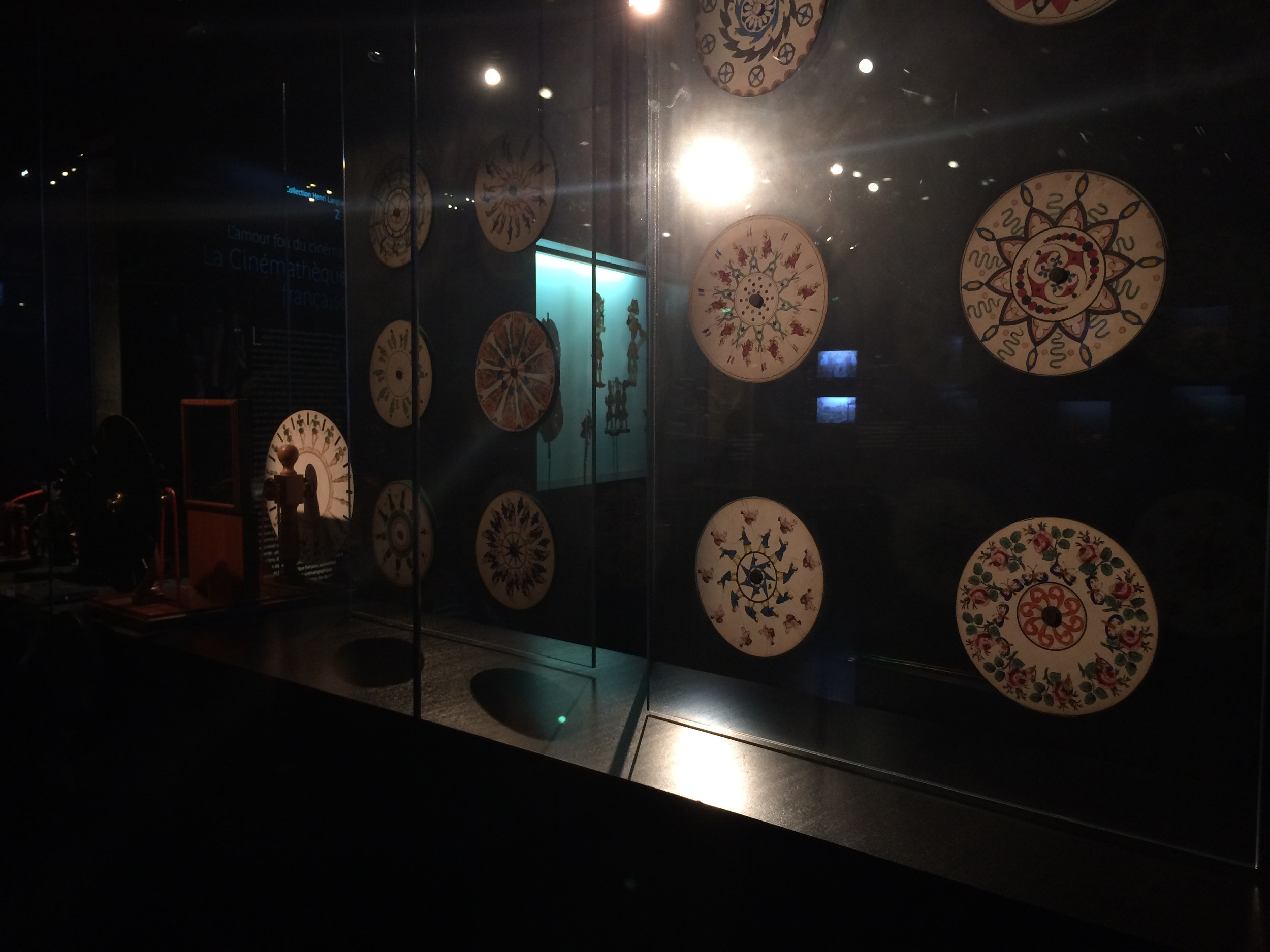 Spinning wheels seen through slits in the reflection of a mirror, called a   phenakistoscope, were available for the public to try.