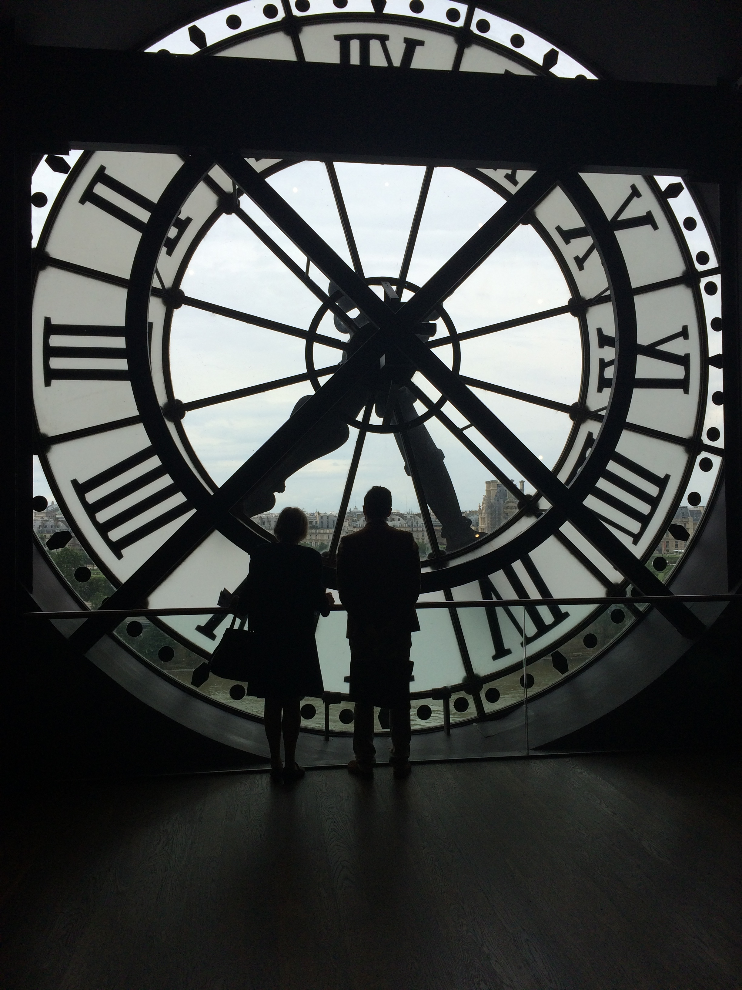 Large clock looking out over the Parisian Landscape.