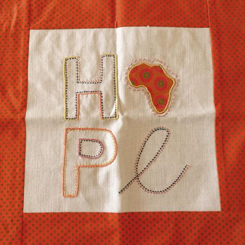 Shweshwe hope cushion cover