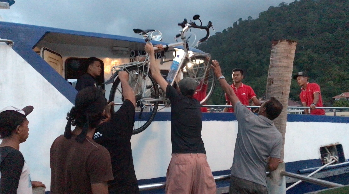 Getting the bikes off the boat