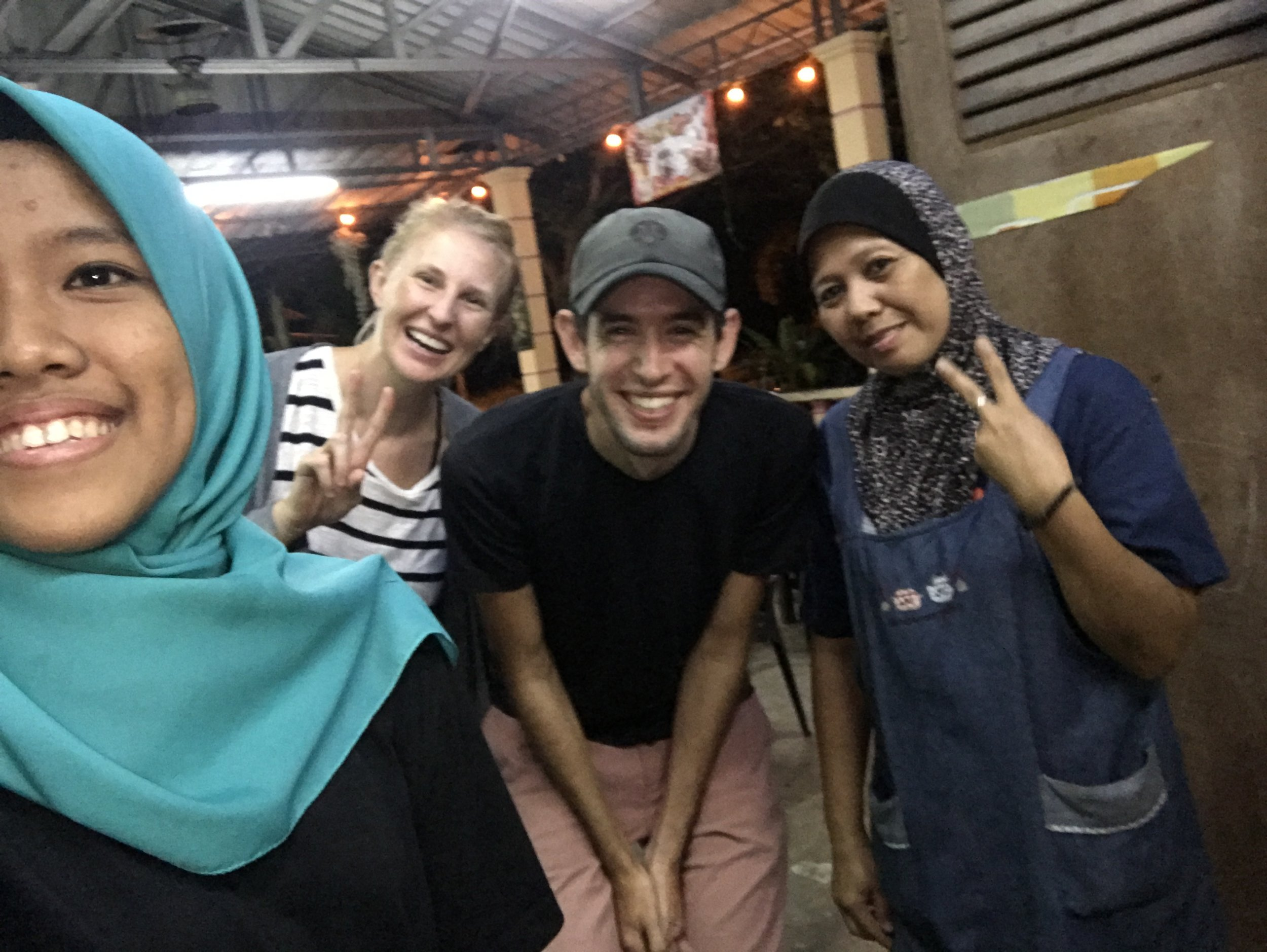 """This is the family that made the fish curry pictured below. They hardly spoke any english, but after we were done eating the daughter (on the left) said """"selfie?"""""""