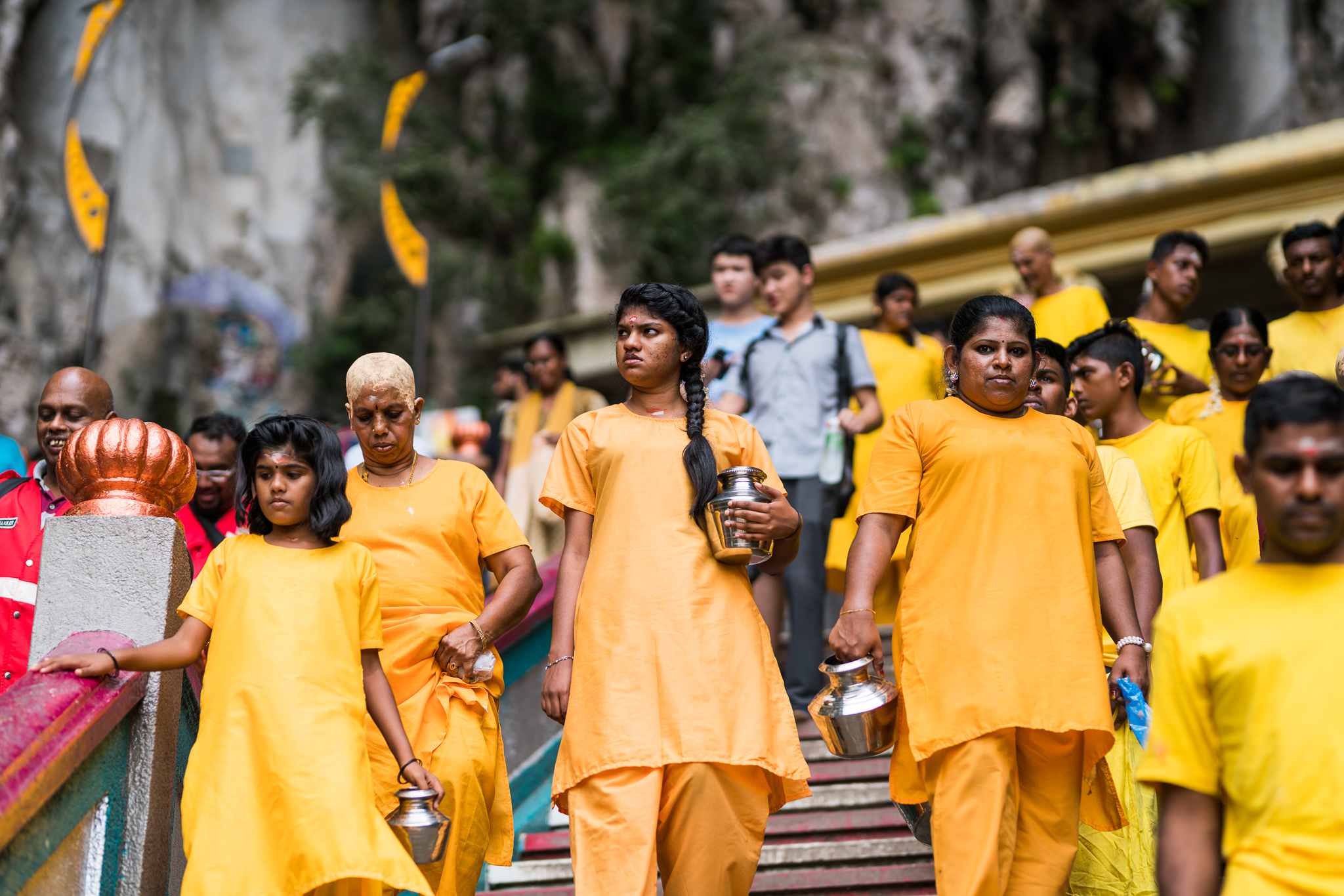 A family dressed in yellow descends the stairs.