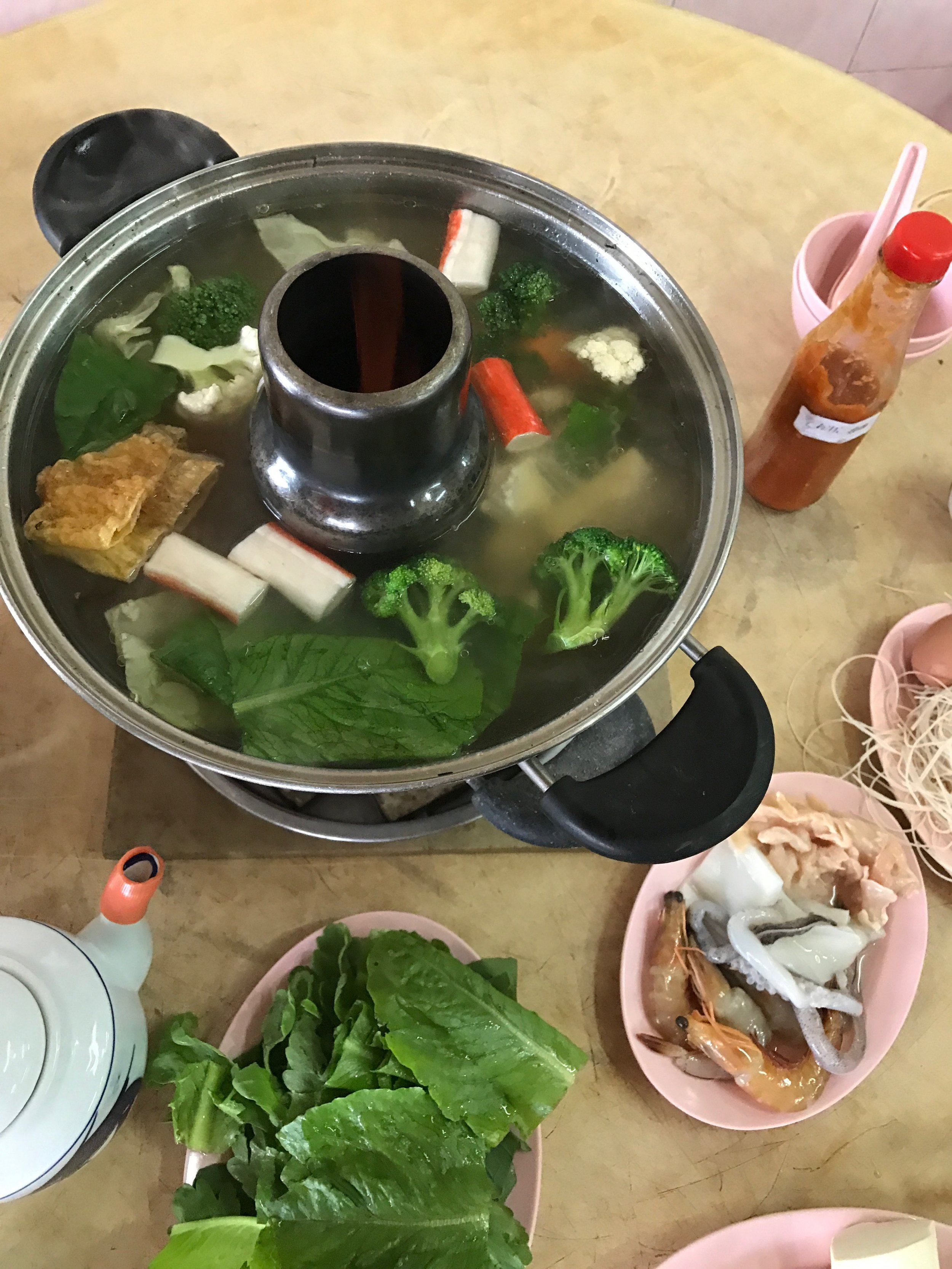 """""""Steamboat"""" - fresh veggies, noodles, and meat (chicken, prawns, squid, etc) which you add to the boiling water in the middle to make a kind of soup. Delicious. The jellyfish was omitted."""