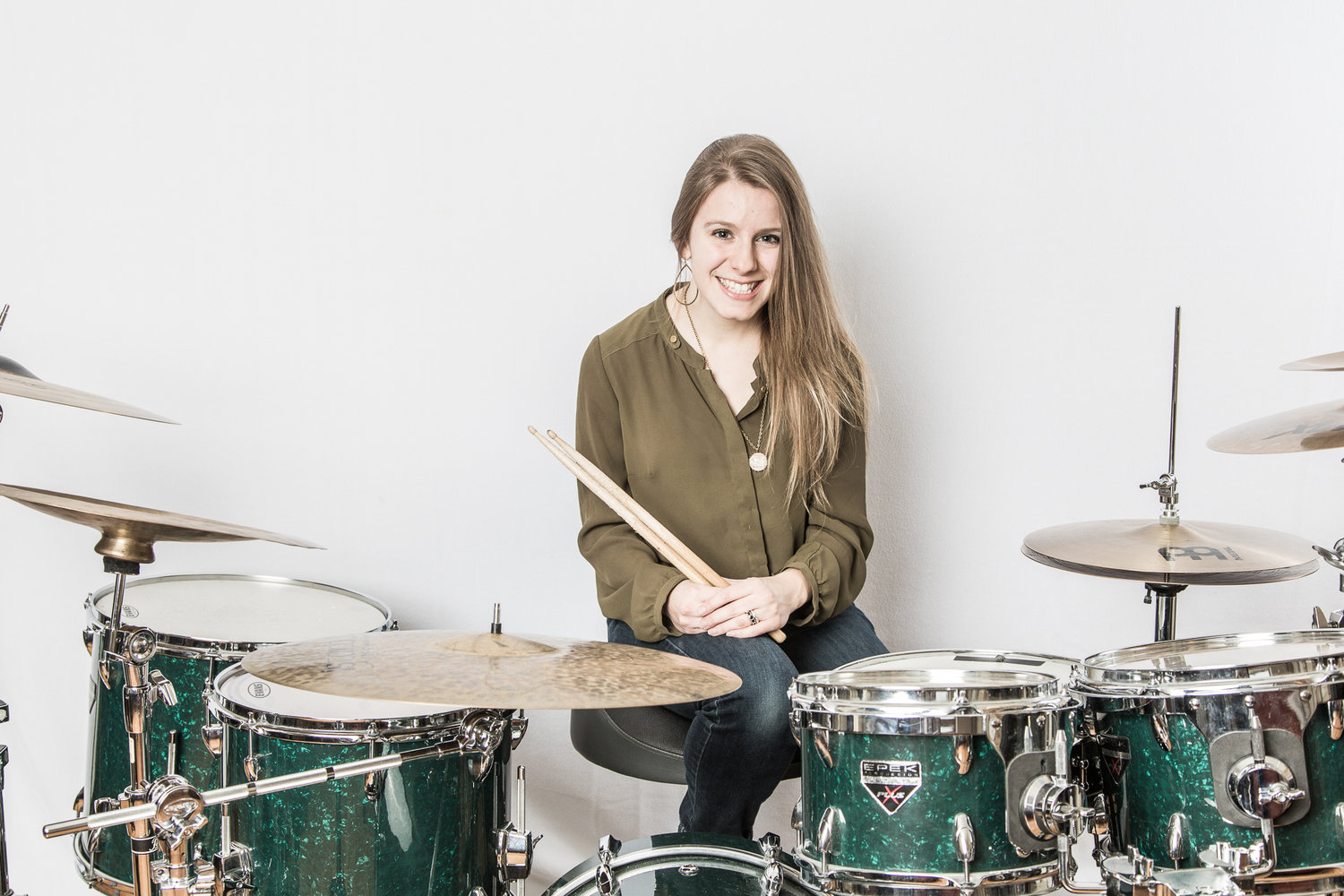 """Hannah Stallings is a drum set player, percussionist, and educator based out of Nashville, TN. She works as a freelance drum set player the live and studio settings, and instructs privately.  As a 12-year-old, Hannah had no idea what instrument to play in the middle school band. She had been taking piano lessons since the ripe age of 4, but piano was not an option in concert band. One day, her dad asked her, """"What's your favorite song?"""" She proceeded to play  Let's Get Loud  by Jennifer Lopez on the boombox, and when asked why, she replied, """"I like the beat"""". It was then obvious to Hannah's dad; she should try percussion.  Since then, Hannah has completed a Diploma in Music Performance from  Grant MacEwan University  in her hometown Edmonton, Canada in 2010, and a Bachelors in Music Education from  Berklee College of Music  in Boston, MA in 2014. She has performed, toured, and recorded internationally with a number of artists, notably CCM songwriter Ginny Owens, R&B/pop artists Marc Evan Diaz and Ashe, blues/Americana band Swingin Hammers, and Nashville's premiere all-female country group Fading June. She also had appearances on ABC's  Nashville , Season 4.   Hannah also loves to teach, and she cherishes seeing her students develop musically and experience the joy of learning and growing as a musician. Hannah has had experience in the public school system as both a substitute teacher K-12 and a Special Education Teachers Assistant K-5, instructed drum set and directed performance groups at the School of Rock in Nashville, TN, and has taught drum set privately since 2009. She has recently begun managing David Spencer Music Group in-home music lessons studio, based in Brentwood, TN."""