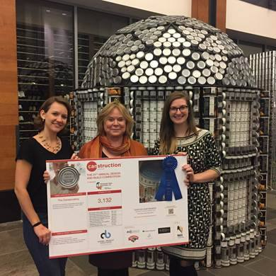 Susie and Katrina posing in front of our CAN-Servatory with Ellen from Project Bread.