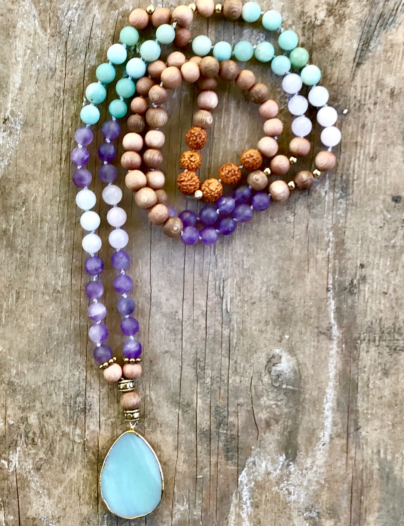 Process - Once you email me sharon@sharonotness.com the process begins. We will schedule a 30 minute phone consultation. I will coach you during our time together and gather information to make this Mala uniquely yours. We will discuss your desires, dreams, goals and intentions as well as color and metal preferences, tassel or pendant. I design the piece, and ship it to you.