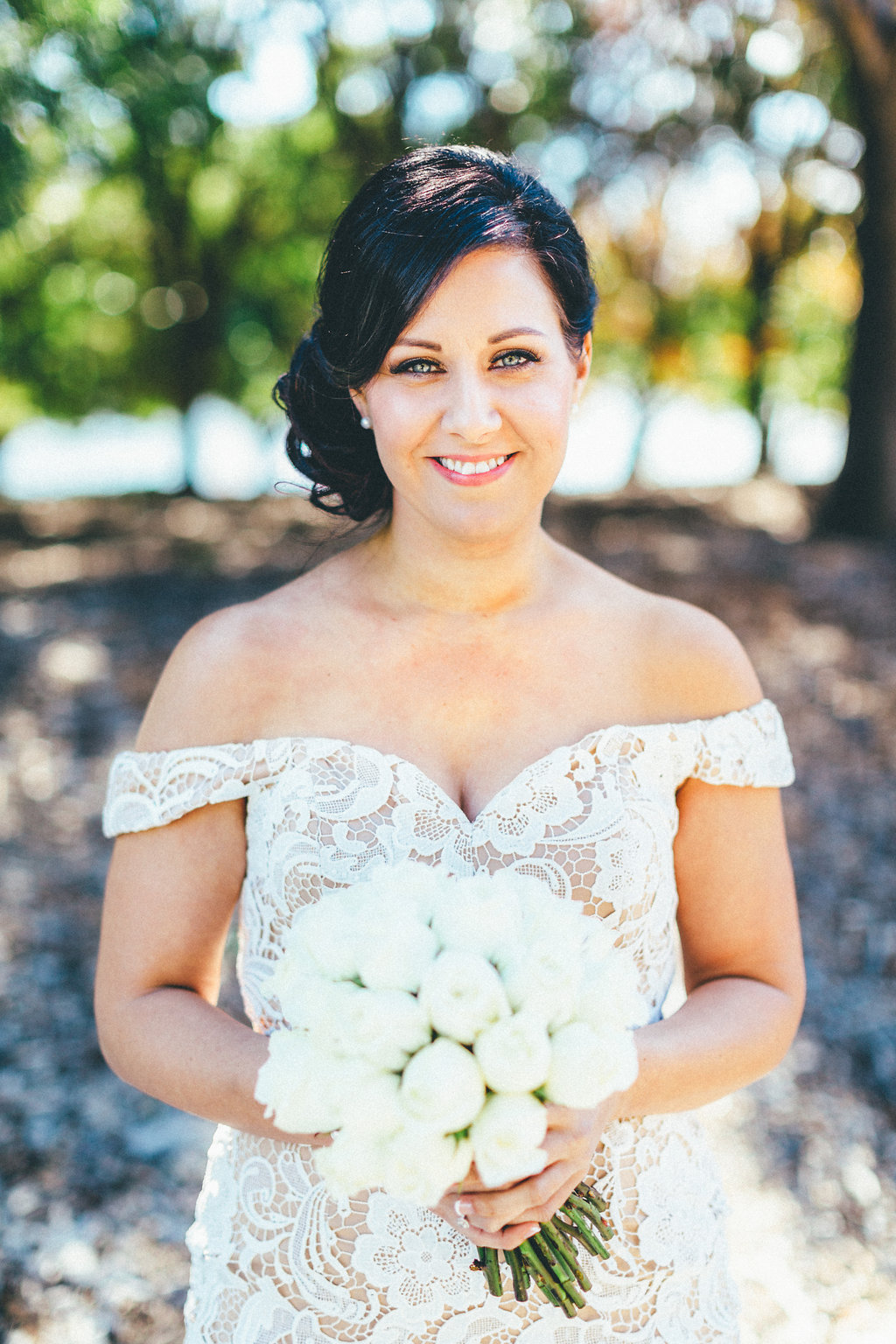 Bride with flowers juste before getting married - Canberra Small Weddings