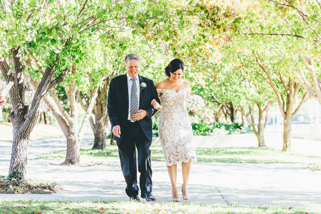 Father and bride walking down the aisle at Lake Burley Griffin - Canberra Small Weddings