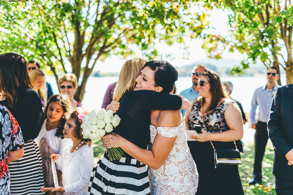 Guest with bride at a wedding by the foreshore of Lake Burley Griffin - Canberra Small Weddings