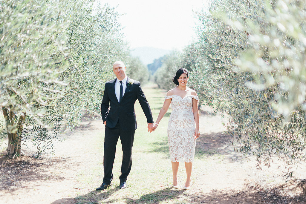 Bride and Groom amongst the olive trees at Pialligo Estate